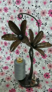 Pauls Metal Petals<br>Stands behind sewing machine to use thread cones<br>Heavy weight<br>Retail $70<br><br>