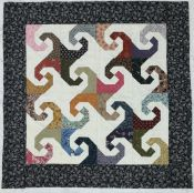 Swirls<br>22 1/2 square<br>Quilt Top, Backing, 100% Cotton Batting included<br><br>
